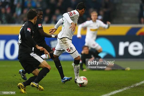 Igor de Camargo of Moenchengladbach scores the first goal during the Bundesliga match between VfL Borussia Moenchengladbach and SC Freiburg at...