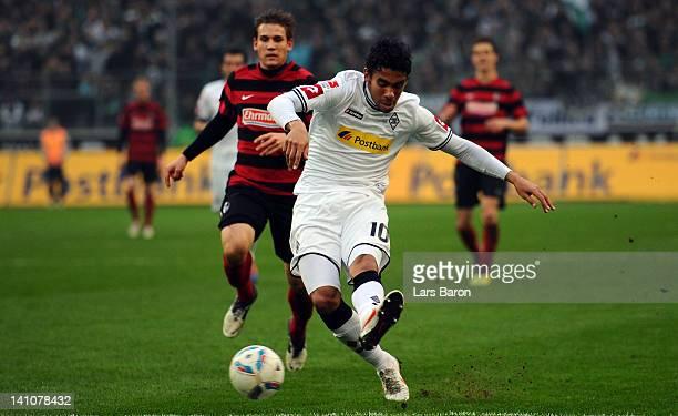 Igor de Camargo of Moenchengladbach shoots on goal during the Bundesliga match between Borussia Moenchengladbach and SC Freiburg at Borussia Park...