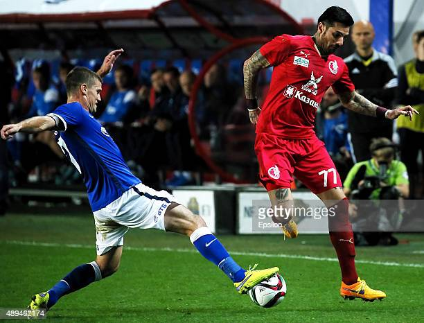 Igor Denisov of FC Dinamo Moscow is challenged by Blagoy Georgiev of FC Rubin Kazan during the Russian Premier League match between Dinamo Moscow and...