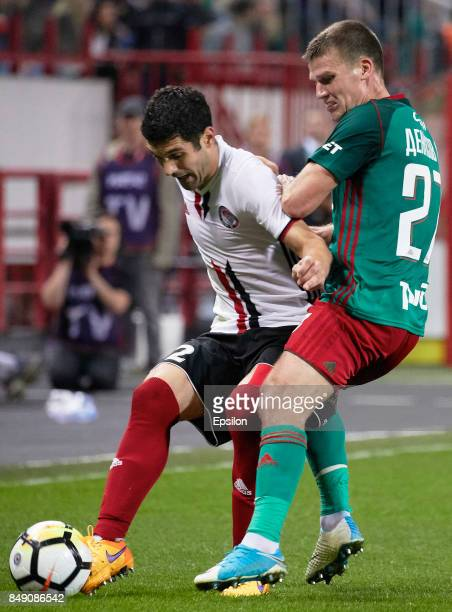 Igor Denisov of FC Lokomotiv Moscow vies for the ball with Alexander Milkovich of FC Amkar Perm during the Russian Premier League match between FC...