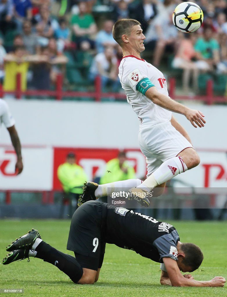 Igor Denisov of FC Lokomotiv Moscow vies for the ball with Rustem Mukhametshin of FC Tosno Khabarovsk during the Russian Premier League match between FC Lokomotiv Moscow and FC Tosno at Lokomotiv stadium on August 13, 2017 in Moscow, Russia.