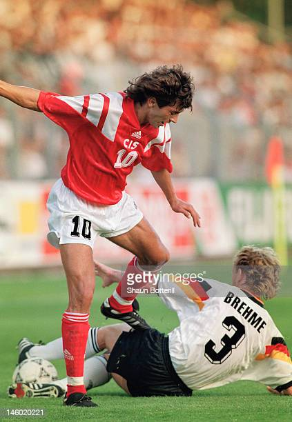 Igor Dobrovolski of USSR is tackled by Andreas Brehme of Germany during the UEFA European Championships 1992 Group 2 match between USSR and Germany...