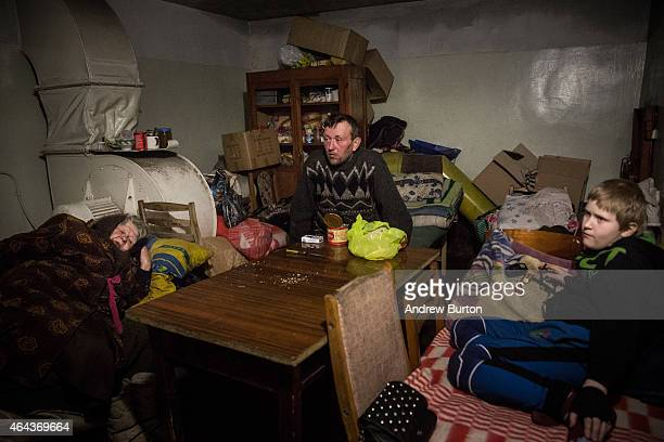 Igor Jakoulevna pauses while eating lunch with his family in the basement of an administrative building where people have been living since August...