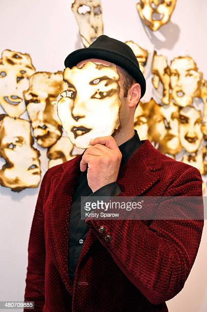 Igor Josifov poses with his art during the Paris Art Fair at Le Grand Palais on March 26 2014 in Paris France