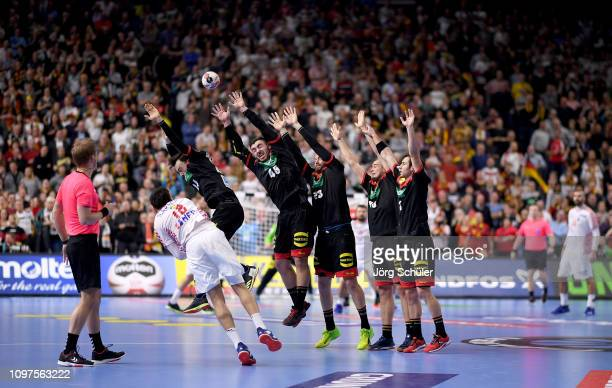 Igor Karacic of Croatia tries to score during the 26th IHF Men's World Championship group 1 match between Croatia and Germany at Lanxess Arena on...