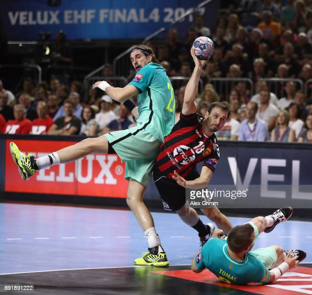 Igor Karadzic of Vardar is challenged by Viran Morros de Argila and Viktor Tomas Gonzalez of Barcelona during the VELUX EHF FINAL4 Semi Final between...