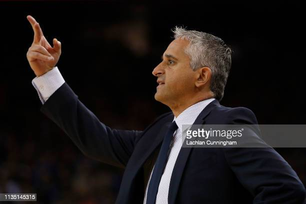 Igor Kokoskov head coach of the Phoenix Suns gives directions to his players during the game against the Golden State Warriors at ORACLE Arena on...