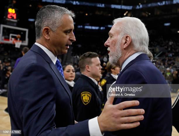 Igor Kokoskov head coach of the Phoenix Suns talks with Gregg Popovich head coach of the San Antonio Spurs before an NBA game held January 29, 2019...