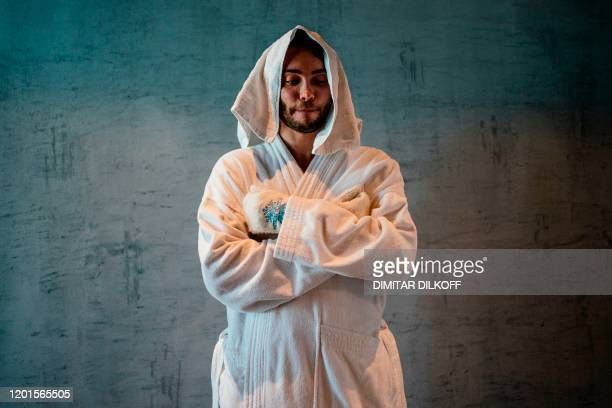 Igor Korabelnikov poses in a bathrobe after standing in a chamber chilled by liquid nitrogen to minus 120 degrees Celsius following exercising on a...