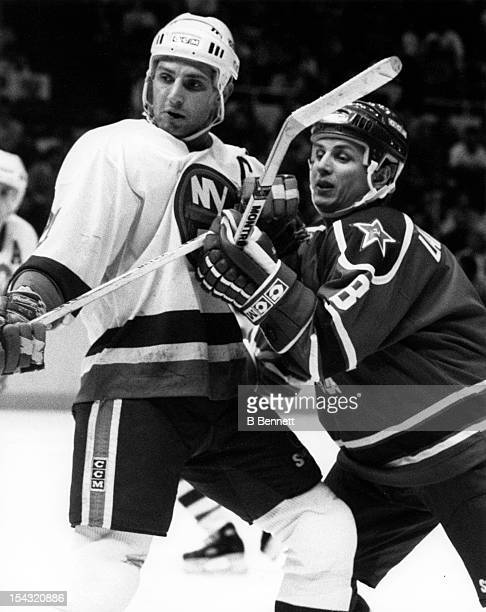 Igor Larionov of CSKA Moscow battles with Brent Sutter of the New York Islanders during their game on December 29, 1988 at the Nassau Coliseum in...