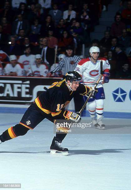 Igor Larionov of the Vancouver Canucks skates on the ice during an NHL game against the Montreal Canadiens on March 9 1991 at the Montreal Forum in...