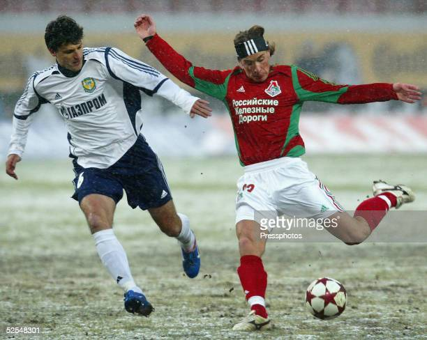 Igor Lebedenko of Lokomotiv is challenged by Albert Borzenkov of Tom during the Football Russian League Championship match between Lokomotiv Moscow v...