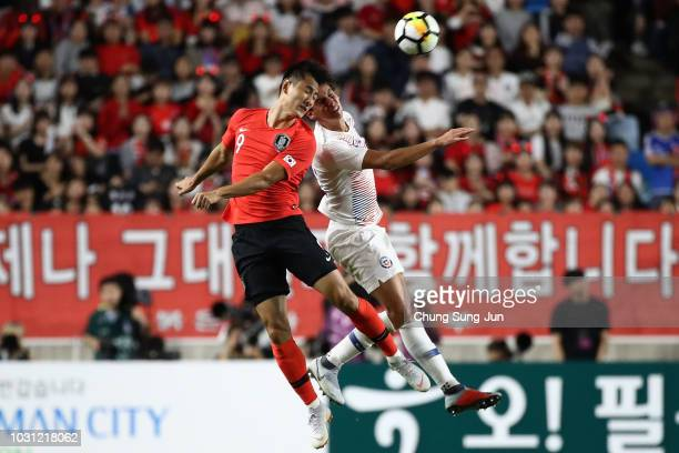 Igor Lichnovsky of Chile competes for the ball with Ji DongWon of South Korea during the International friendly match between South Korea and Chile...