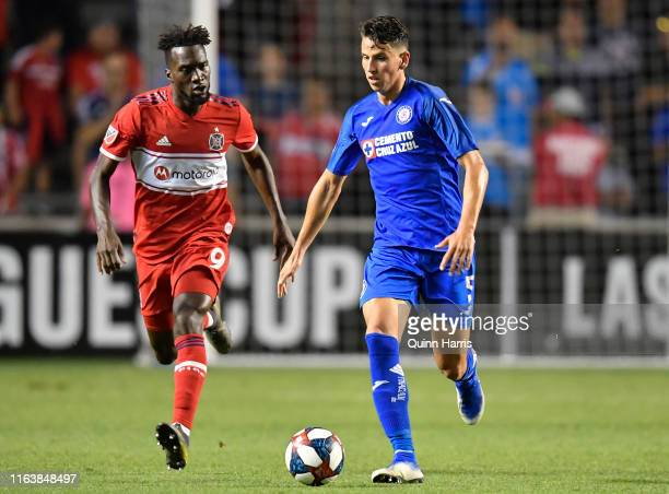 Igor Lichnovsky of Cruz Azul dribbles the ball in front of CJ Sapong of Chicago Fire in the second half at SeatGeek Stadium on July 23 2019 in...