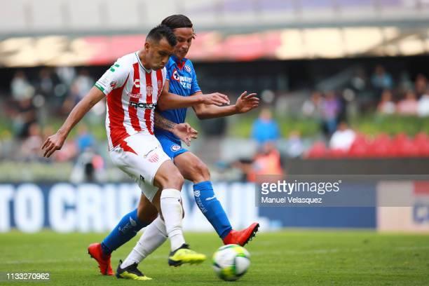 Igor Lichnovsky of Cruz Azul struggles for the ball against Rodrigo Contreras of Necaxa during the 9th round match between Cruz Azul and Necaxa as...