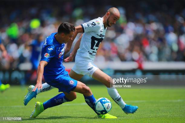 Igor Lichnovsky of Cruz Azul struggles for the ball with Carlos Gonzalez of Pumas during the 10th round match between Pumas UNAM and Cruz Azul as...