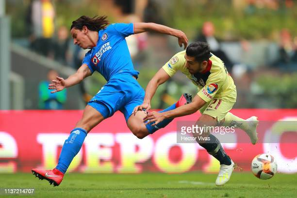 Igor Lichnovsky of Cruz Azul struggles for the ball with Henry Martin of America during the 14th round match between America and Cruz Azul as part of...