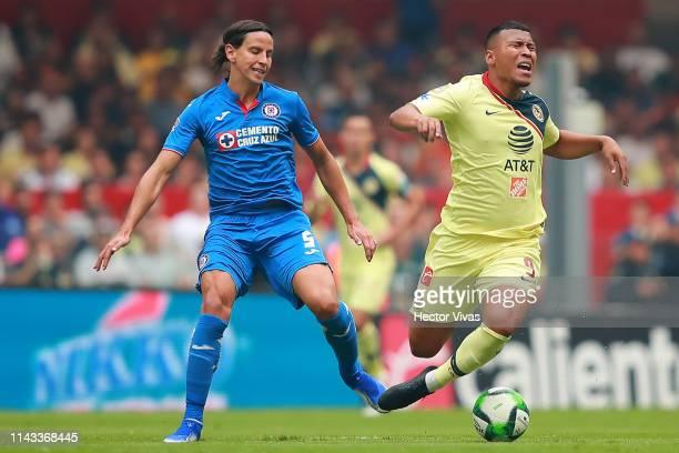 Igor Lichnovsky of Cruz Azul struggles for the ball with Roger Martinez of America during the quarterfinals second leg match between Cruz Azul and...