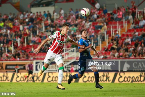 Igor Lichnovsky of Necaxa and Christian Marrugo of Puebla fight for the ball during the 9th round match between Necaxa and Puebla as part of the...