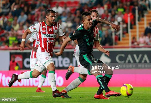 Igor Lichnovsky of Necaxa and Jesus Isijara of Santos fight for the ball during the 10th round match between Necaxa and Santos Laguna as part of the...