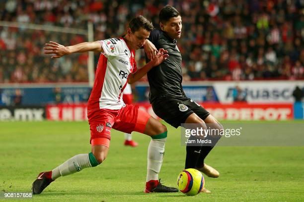 Igor Lichnovsky of Necaxa and Ronaldo Cisneros of Chivas compete for the ball during the third round match between Necaxa and Chivas as part of...