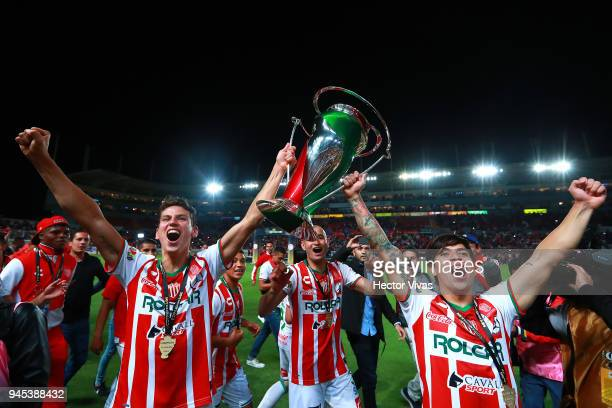 Igor Lichnovsky of Necaxa Carlos Gonzalez of Necaxa and Marcelo Allende of Necaxa celebrate with the champion trophy during the Championship match...
