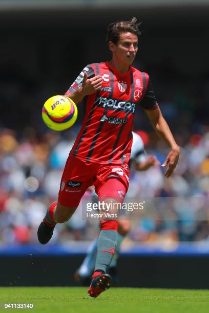 Igor Lichnovsky of Necaxa drives the ball during the 13th round match between Pumas UNAM and Necaxa as part of the Torneo Clausura 2018 Liga MX at...