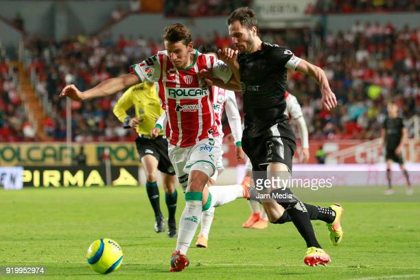 Igor Lichnovsky of Necaxa fights for the ball with Jose Basanta of Monterrey during the 8th round match between Necaxa and Monterrey as part of the...