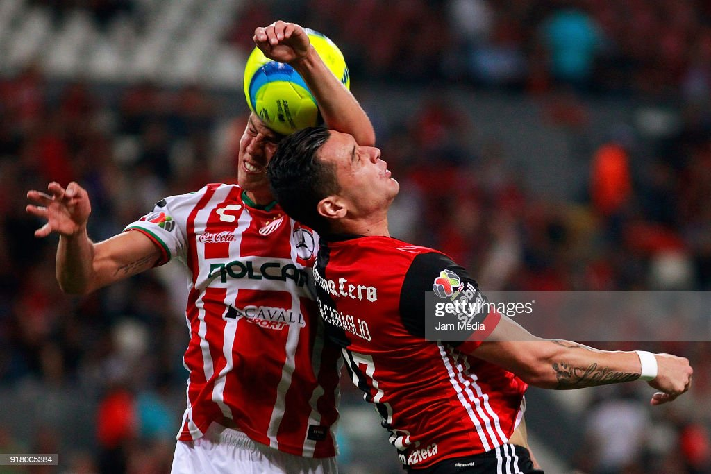 Igor Lichnovsky (L) of Necaxa heads for the ball with Milton Caraglio (R) of Atlas during the 7th round match between Atlas and Necaxa as part of the Torneo Clausura 2018 Liga MX at Jalisco Stadium on February 13, 2018 in Guadalajara, Mexico.