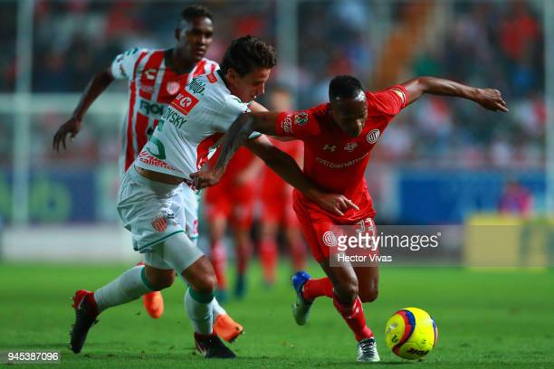 Igor Lichnovsky of Necaxa struggles for the ball with Luis Quinones of Toluca during the Championship match between Necaxa and Toluca as part of the...