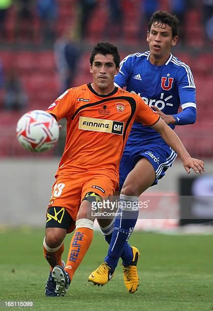 Igor Lichnovsky of Universidad de Chile struggles for the ball with Francisco Pizarro of Cobreloa during a match between Universidad de Chile and...