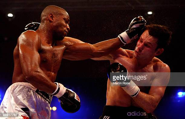 Igor Michalkin of Russia exchanges punchs with Doudou Ngumbu of France during the light heavyweight fight during the Universum Champions night boxing...
