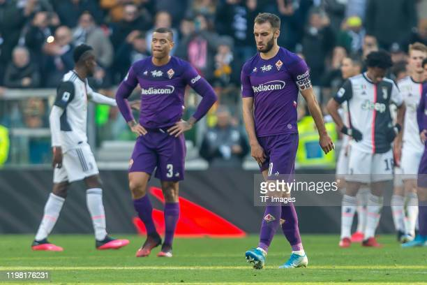 Igor of ACF Fiorentina and German Pezzella of ACF Fiorentina look dejected after the Serie A match between Juventus and ACF Fiorentina at Allianz...