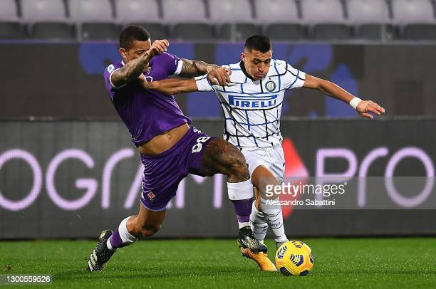 Igor of ACF Fiorentina competes for the ball with Alexis Sanchez of FC Internazionale during the Serie A match between ACF Fiorentina and FC...