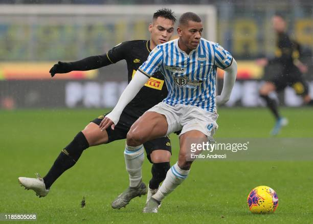 Igor of Spal is challenged by Lautaro Martinez of FC Internazionale during the Serie A match between FC Internazionale and SPAL at Stadio Giuseppe...