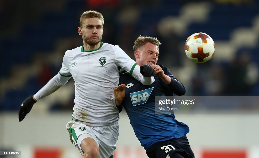 Igor Plastun of PFC Ludogorets Razgrad and Robin Hack of 1899 Hoffenheim battle for possession during the UEFA Europa League group C match between 1899 Hoffenheim and PFC Ludogorets Razgrad at Wirsol Rhein-Neckar-Arena on December 7, 2017 in Sinsheim, Germany.