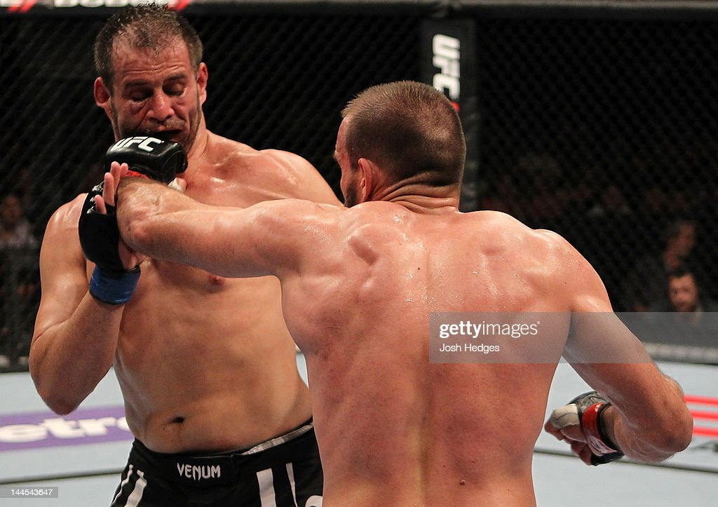 Igor Pokrajac punches Fabio Maldonado in a light heavyweight bout during the UFC on Fuel TV event at Patriot Center on May 15, 2012 in Fairfax, Virginia.