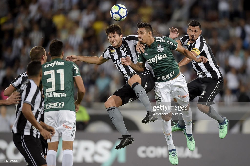 Igor Rabello (R) and Rodrigo Lindoso (L) of Botafogo struggles for the ball with Antônio Carlos of Palmeiras during the match between Botafogo and Palmeiras as part of Brasileirao Series A 2018 at Engenhao Stadium on April 16, 2018 in Rio de Janeiro, Brazil.