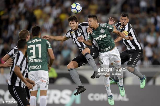 Igor Rabello and Rodrigo Lindoso of Botafogo struggles for the ball with Antônio Carlos of Palmeiras during the match between Botafogo and Palmeiras...