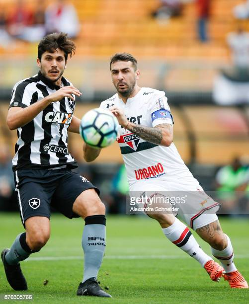 Igor Rabello of Botafogo and Lucas Pratto of Sao Paulo in action during the match for the Brasileirao Series A 2017 at Pacaembu Stadium on November...