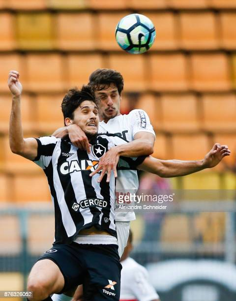 Igor Rabello of Botafogo and Rodrigo Caio of Sao Paulo in action during the match for the Brasileirao Series A 2017 at Pacaembu Stadium on November...