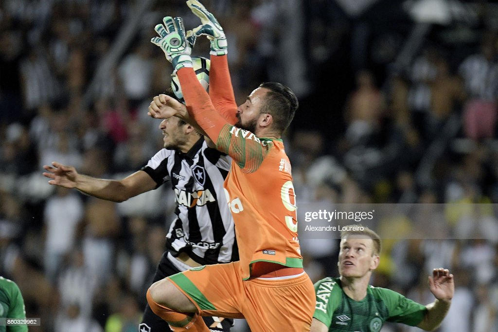 Igor Rabello (L) of Botafogo battles for the ball with Jandrei (R) of Chapecoense during the match between Botafogo and Chapecoense as part of Brasileirao Series A 2017 at Engenhao Stadium on October 11, 2017 in Rio de Janeiro, Brazil.