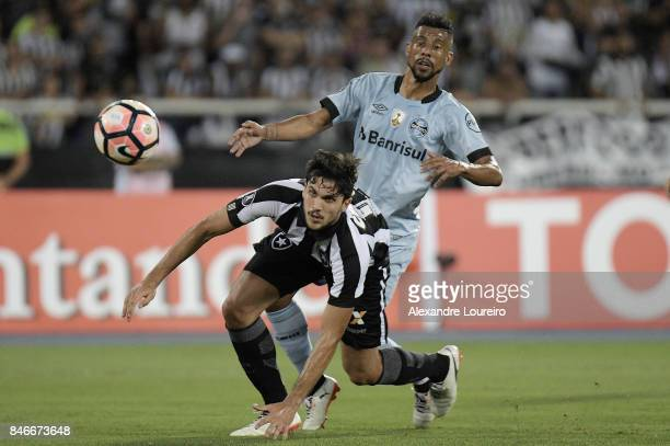 Igor Rabello of Botafogo battles for the ball with Leo Moura of Gremio during the match between Botafogo and Gremio as part of Copa Bridgestone...