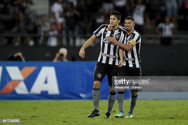 Igor Rabello of Botafogo celebrates their first scored goal with Rodrigo Lindoso during the match between Botafogo and Palmeiras as part of...