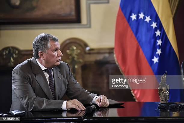 Igor Sechin chief executive officer of Rosneft PJSC listens as Nicolas Maduro president of Venezuela not pictured speaks to the media after Sechin...