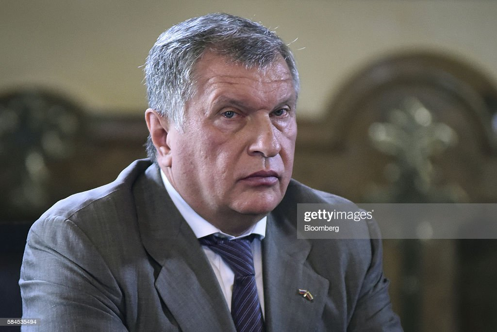 Igor Sechin, chief executive officer of Rosneft PJSC, listens as Nicolas Maduro, president of Venezuela, not pictured, speaks to the media after Sechin and Eulogio del Pino, president of Petroleos de Venezuela SA (PDVSA), not pictured, signed natural gas deals in Caracas, Venezuela, on Thursday, July 28, 2016. The agreements included a deal for Rosneft to participate in the Mariscal Sucre natural gas project. Photographer: Carlos Becerra/Bloomberg via Getty Images