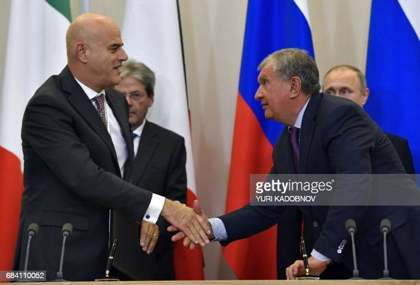 Igor Sechin the CEO of oil giant Rosneft shakes hands with Claudio Descalzi Chief Executive Officer of Italian energy group Eni during a signing...