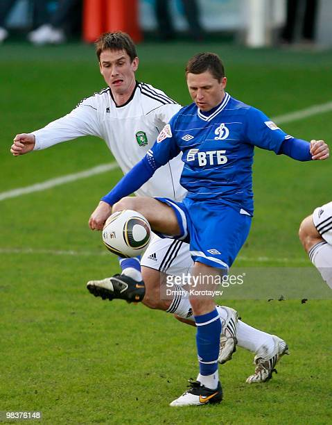 Igor Semshov of FC Dynamo Moscow battles for the ball with Dmitri Michkov of FC Tom Tomsk during the Russian Football League Championship match...