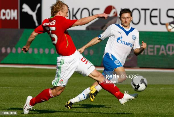 Igor Semshov of FC Zenit St Petersburg battles for the ball with Renat Yanbayev of FC Lokomotiv Moscow during the Russian Football League...