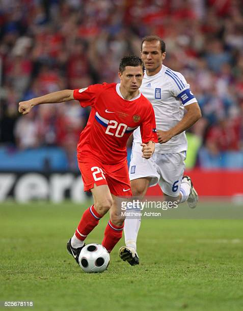 Igor Semshov of Russia and Angelos Basinas of Greece during the UEFA EURO 2008 Group D preliminary round match between Greece and Russia at the...